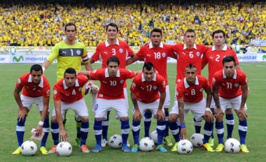 Chile's national football team poses for pictures before the start of the Brazil 2014 FIFA World Cup South American qualifier match against Colombia, in Barranquilla, Colombia, on October 11, 2013. (Standing, L-R) Goalkeeper Claudio Bravo, defender Marcos Gonzalez, defender Gonzalo Jara, midfielder Carlos Carmona and defender Eugenio Mena. (Front row L-R) Forward Alexis Sanchez, defender Mauricio Isla, midfielder Jorge Valdivia, defender Gary Medel, midfielder Arturo Vidal and forward Eduardo Vargas.  AFP PHOTO / LUIS ACOSTA        (Photo credit should read LUIS ACOSTA/AFP/Getty Images)